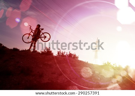 Sport and healthy life.Mountain bike and sunset.Extreme sport - stock photo