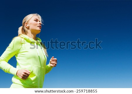 sport and lifestyle concept - woman doing running outdoors - stock photo