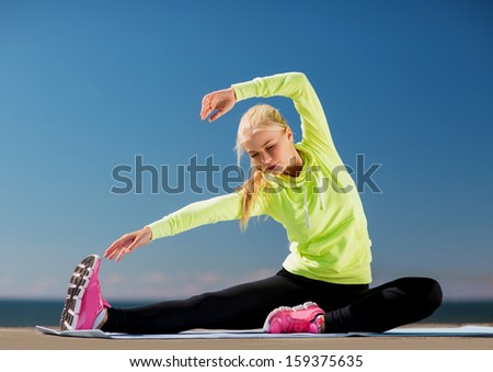 sport and lifestyle concept - woman doing sports outdoors - stock photo