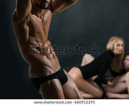 sport and love relations of sexy couple near muscular athletic man with strong body and torso