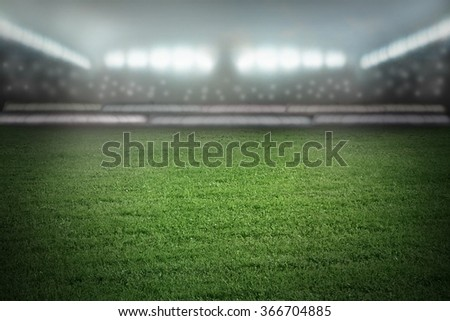 Sport arena of football or soccer, stadium in spotlights - stock photo