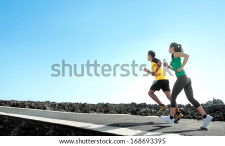 sport - asian couple running outdoor doing exercise - stock photo