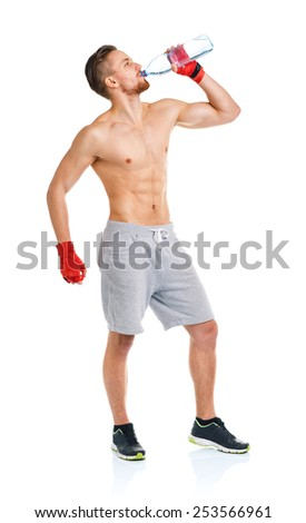 Sport attractive man wearing boxing bandages with bottle of water on the white background