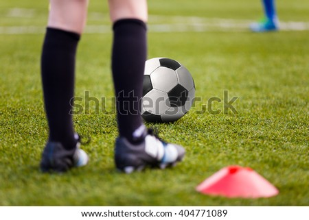 Sport Background. Soccer Football Player with Ball; Boys Playing Soccer Match on Training Field. - stock photo