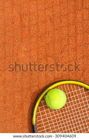 Sport background with a tennis racket and ball. Vertical image. - stock photo