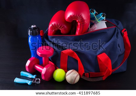 Sport bag for packing your exercise item with black background. - stock photo