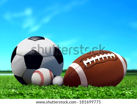 Sport Balls on Grass with Blue Sky