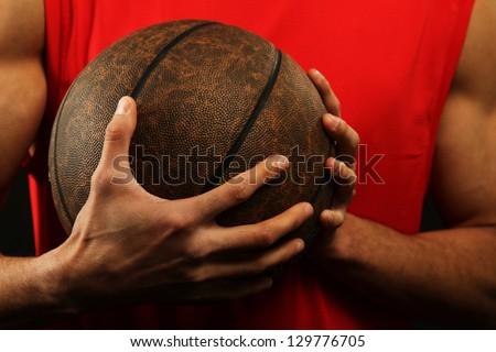 Sport - Basketball player holding ball - stock photo
