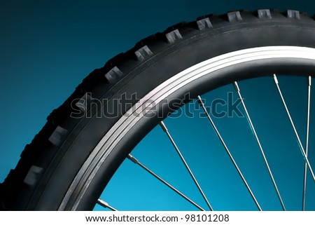Sport bicycle tire and spoke wheel - stock photo
