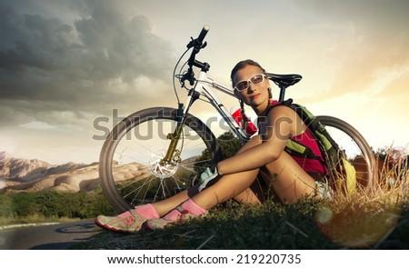 Sport bike woman on a rock - stock photo