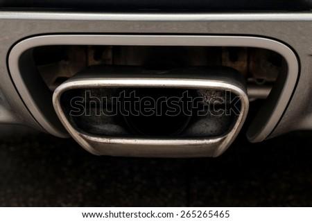 Sport car exhaust. Auto exterior detail. - stock photo