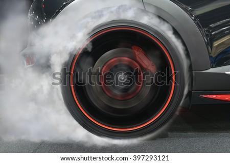 sport car wheel drifting and smoking on track dark edition  - stock photo