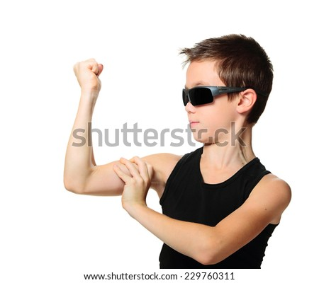 Sport child boy showing his hand biceps muscles strength isolated on white background - stock photo