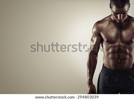 Sport. Close up image of muscular african male in sports clothing - stock photo