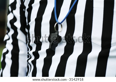 Sport competition referee. Judge concept. Referee suit and a whistle - stock photo