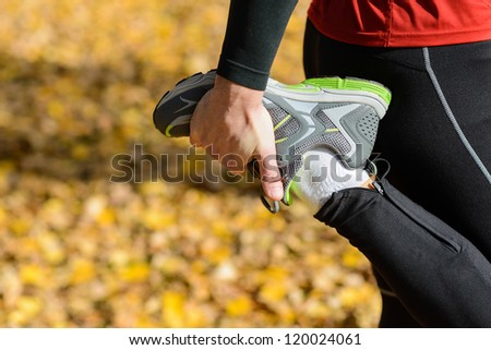 Sport concept. Runner sportsman warming up and stretching before running. Athlete sport shoes. Copy space. - stock photo