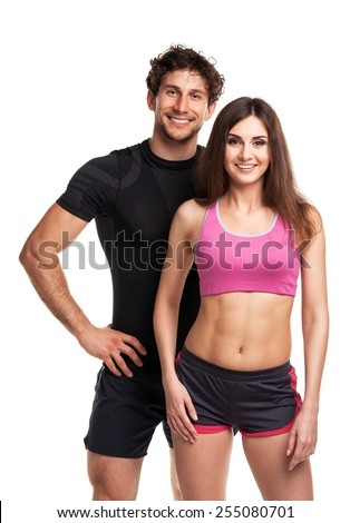 Sport couple - man and woman after fitness exercise on the white background - stock photo