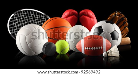 sport equipment and balls in front of black background - stock photo