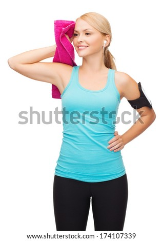 sport, excercise, technology, internet and healthcare - sporty woman with smartphone, earphones and towel