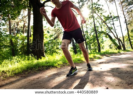 Sport exercise, fitness, workout. Young athlete, runner in shoes. Outdoor activity, endurance. Active person  road training. Healthy lifestyle. People in motion on sunset.