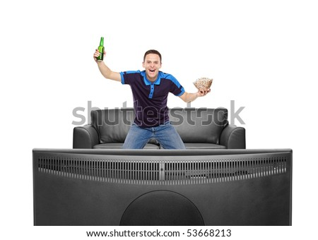 Sport fan with beer bottle and popcorn in his hands watching a match on TV isolated on white background - stock photo