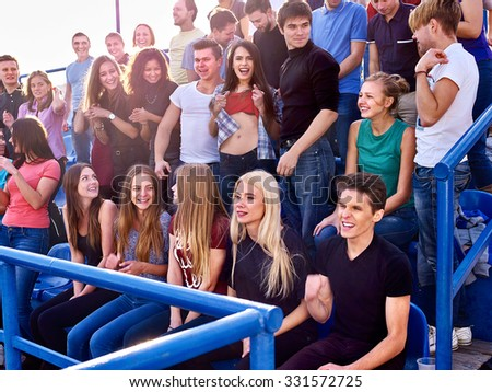 Sport fans beautiful girl and men on tribunes. Group people. - stock photo