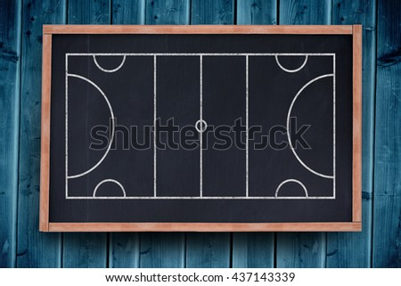 Sport field plan on a black background against blackboard with copy space on wooden board
