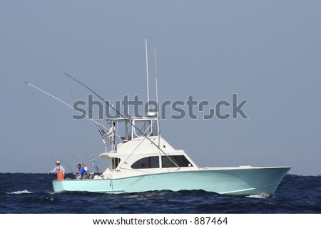 Sport Fishing Boat in the Gulf Stream Reeling in Game Fish - stock photo