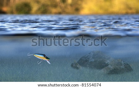 sport fishing lure in use with an underwater  and above water view - stock photo