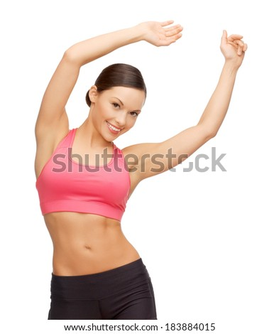 sport, fitness and healthcare concept - beautiful asian sporty woman doing exercise - stock photo