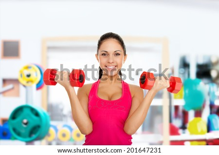 sport fitness excited happy woman, young healthy girl smile gym exercises dumbbells working out in gym - stock photo