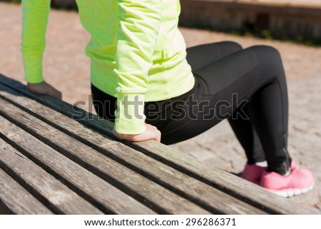 sport, fitness, exercise and lifestyle concept - woman doing sports outdoors - stock photo