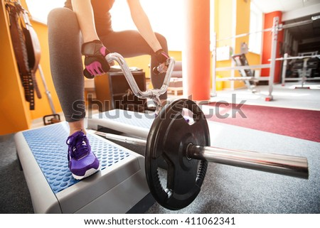 sport, fitness, lifestyle concept - close up of young woman doing sport - stock photo