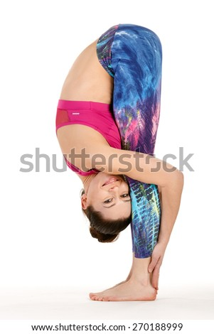 Sport fitness woman doing yoga exercises, forward bend, full length portrait isolated over white background - stock photo