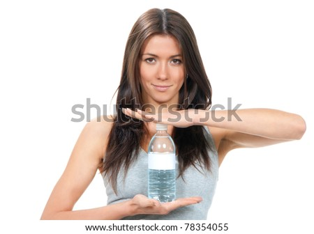 Sport fitness Woman in sportswear holding in hands drinking clear water in plastic advertising bottle isolated on a white background - stock photo