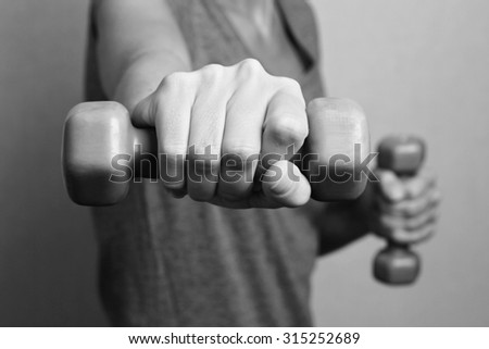 Sport, fitness ,workout concept. Close-up of young woman hand with dumbbell,weights