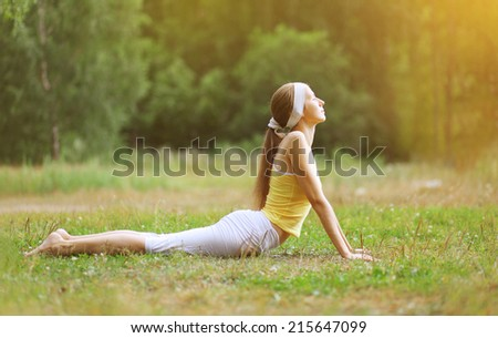 Sport, fitness, yoga - concept, woman doing exercise outdoors - stock photo