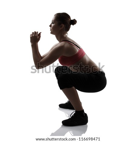 sport girl doing squatting exercise, silhouette studio shot over white background - stock photo