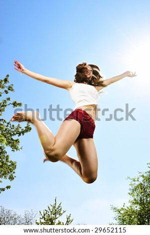 sport girl jumping in nature - stock photo