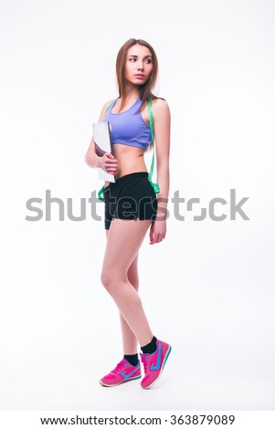 Sport girl Measuring with Weighing Scale and  tape measure  isolated on white background. Health concept - stock photo