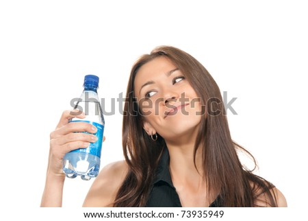 Sport healthy woman looking on a bottle of fresh mineral blue water in her hand on a white background - stock photo