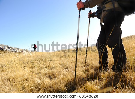 Sport hiking in mountains, walking and backpacking - stock photo