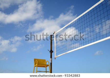 Sport Image Of A Volleyball Net On A Beach With A Referees Chair - stock photo