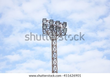 Sport lights with cloudy sky. - stock photo