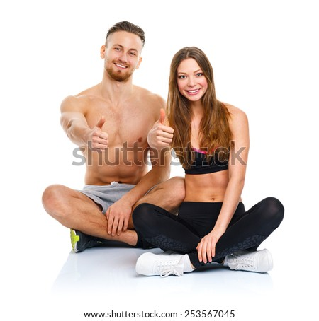 Sport man and woman after fitness exercise with a finger up on the white background - stock photo