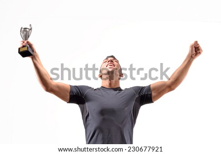 Sport man celebrating holding a trophy cup. - stock photo