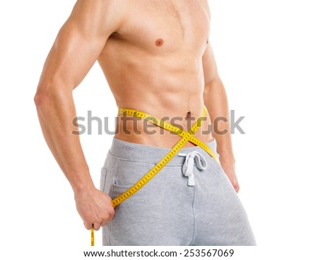 Sport man with measuring tape on the white background - stock photo