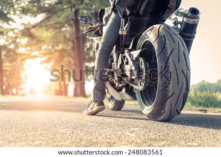 sport motorbike on the side of the road. Biker ready to run - stock photo