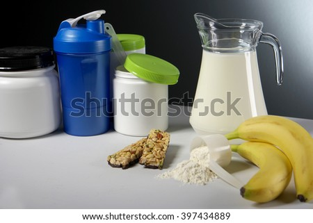 Sport Nutrition Supplement containers with jug of milk