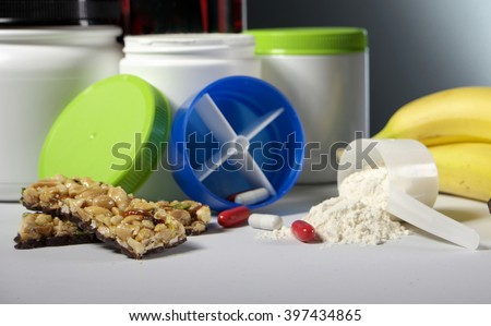 Sport Nutrition Supplement containers with pills - stock photo